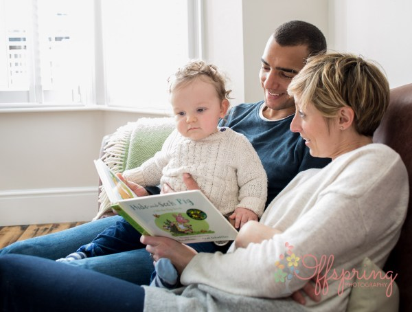 family-reading-on-sofa-with-baby-boy