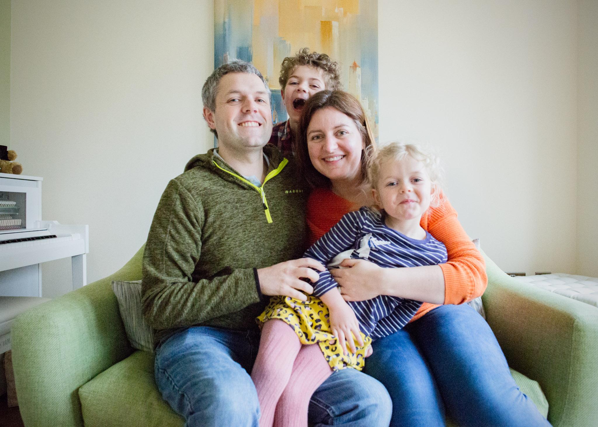 Bailey Lamburn and family on sofa