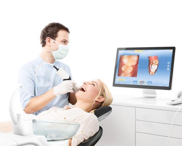 doctor and patient using a CEREC AF unit