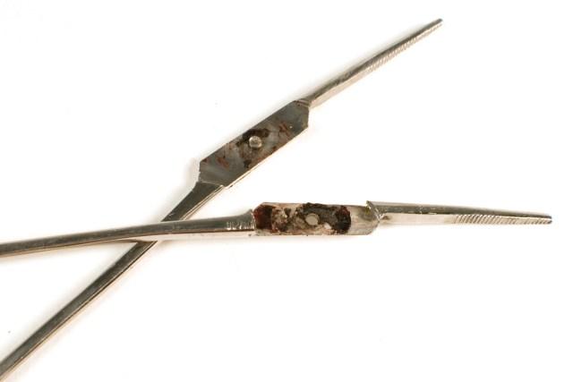 bloody pair of dental forceps