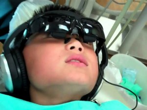 child listening to music at the dentist