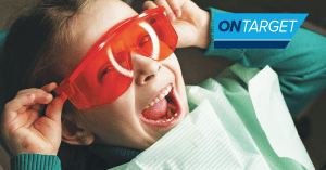 Pediatric dental patient with protective eyewear