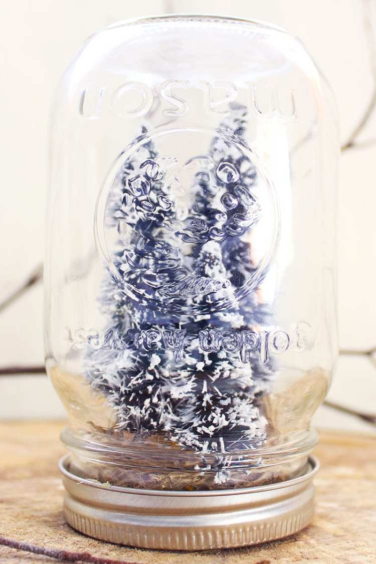 """A """"snow"""" globe made from a reused mason jar, faux trees and burlap. A great addition to your winter craft ideas Pinterest board!"""