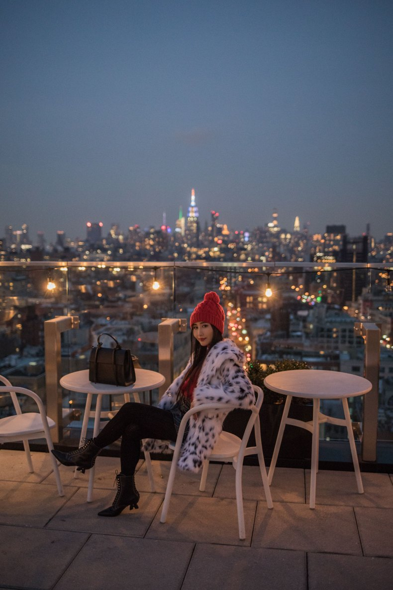 How to Achieve a Stylish Winter Outfit in NYC - Red Pom Pom Beanie, Cable Knit Tights, Leather Skirt, Loewe Lace Up Boots, Red Knit, Spotted Fur Coat, Black XNihilo Bank Bag, Asian Blogger, NYC Fashion Blogger, 50 Bowery Hotel, 50 Bowery Rooftop | in NYC | Ofleatherandlace.com