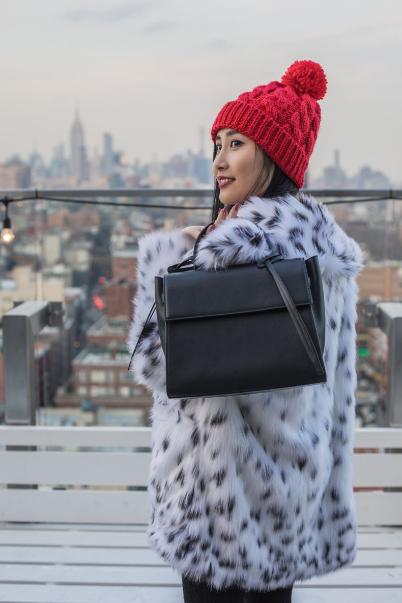 How to Achieve a Stylish Winter Outfit in NYC - Red Pom Pom Beanie, Cable Knit Tights, Spotted Fur Coat, Black XNihilo Bank Bag, Asian Blogger, NYC Fashion Blogger | in NYC | Ofleatherandlace.com