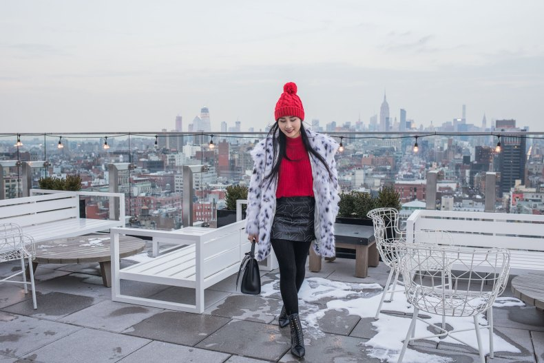 How to Achieve a Stylish Winter Outfit in NYC - Red Pom Pom Beanie, Cable Knit Tights, Leather Skirt, Loewe Lace Up Boots, Red Knit, Spotted Fur Coat, Black XNihilo Bank Bag, Asian Blogger, NYC Fashion Blogger, 50 Bowery Rooftop | in NYC | Ofleatherandlace.com