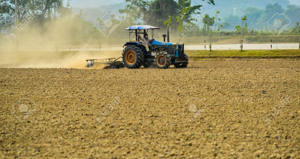20428553-land-preparation-with-tractor-tractor-plows-a-field-agriculture-modern-method-Stock-Photo