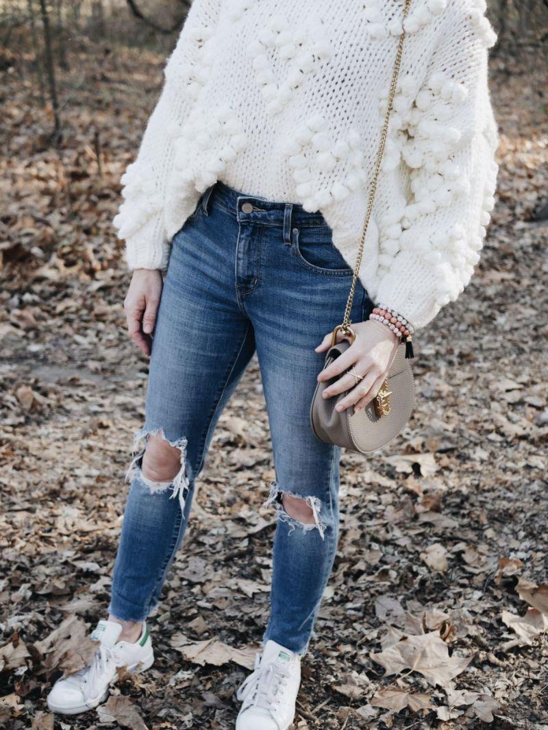 White Pom Pom sweater tucked in