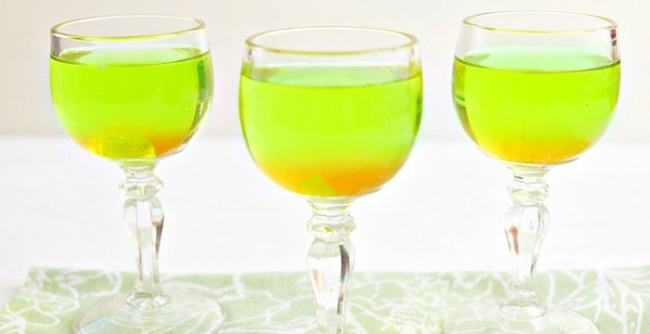 St. Patrick's Day Drink featuring green apple jolly ranchers candy