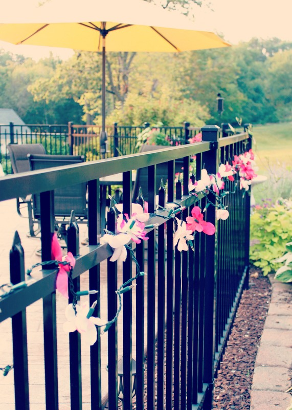 Easy to make outdoor summer party lights using dollar store flowers | OHMY-CREATIVE.COM
