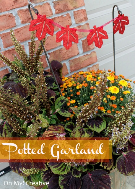 Add a pretty leaf garland to pots of mums for fall!