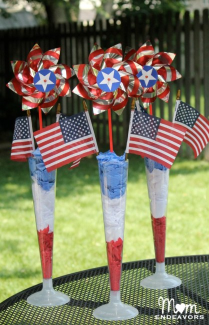 Flag centerpieces made from pinwheels, flags, and tissue paper