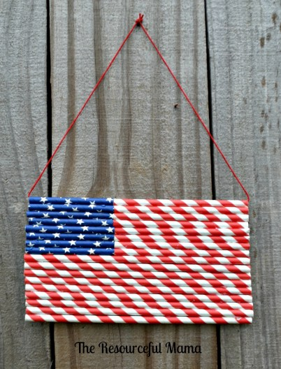 Patterned paper straws combined to create a flag hanger