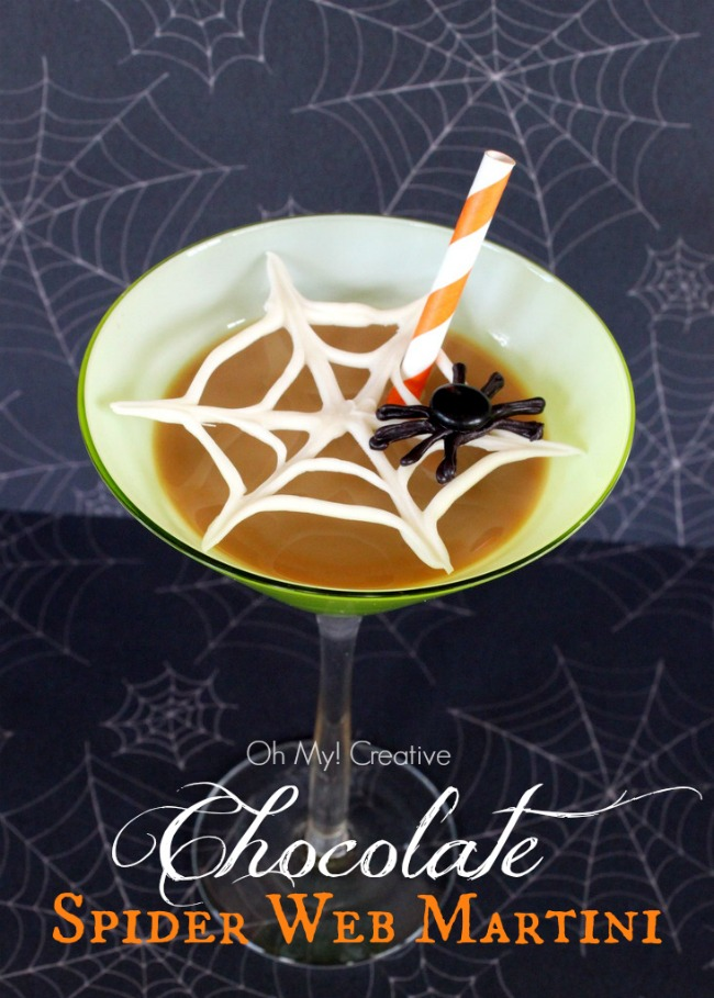 This Spider Web Chocolate Halloween Martinis will make a frightful Halloween cocktail your guest will rave about later! OHMY-CREATIVE.COM #halloweenmartinis #halloweencocktail #halloweendrinks #spiderweb #spider #halloweenpartyideas