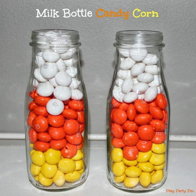 Milk bottle candy corn 15 Candy Corn Desserts & Crafts - OhMy-Creative.com | Candy Corn Cupcakes | Candy Corn Desserts | Candy Corn Crafts | Halloween Rice Krispie Treats | Halloween Treats | Candy Corn Marshmallows | Candy Corn Recipe