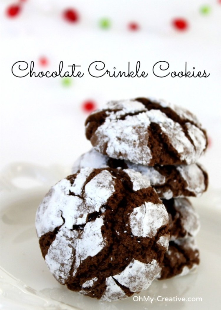 The soft chewy texture along with a dusting of powdered sugar make these Chocolate Crinkle Cookies a perfect holiday sweet! An absolute perfect Chistmas Cookie Recipe - Yum! | OHMY-CREATIVE.COM