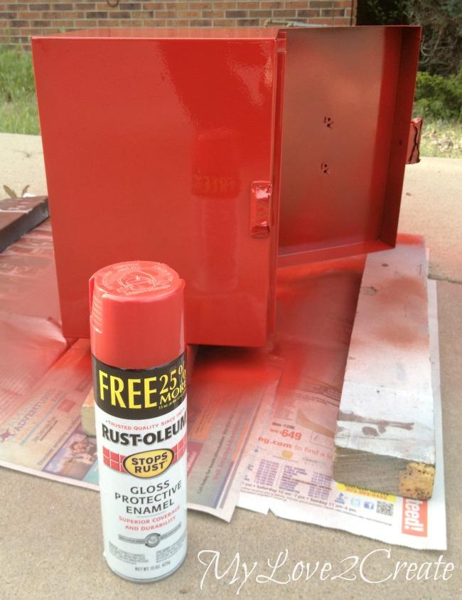 Spray painting metal box red