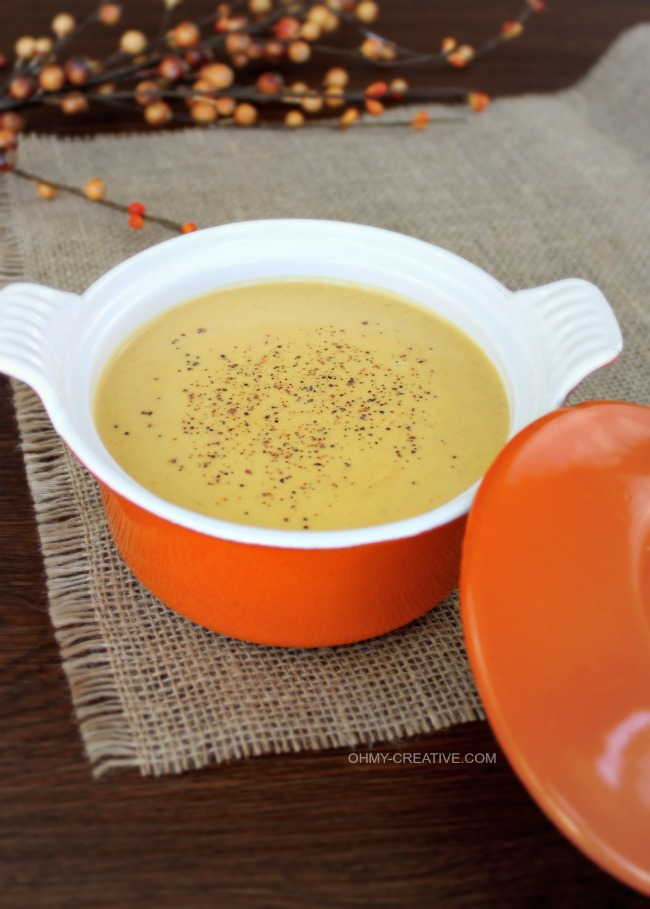 This Creamy Pumpkin Soup Recipe is easy to make and tasty for Fall or all winter long. An easy pumpkin soup recipe great for lunch, dinner appetizer! OHMY-CREATIVE.COM #pumpkinsouprecipe #souprecipe #soup #pumpkinrecipe #sidedish #pumpkin