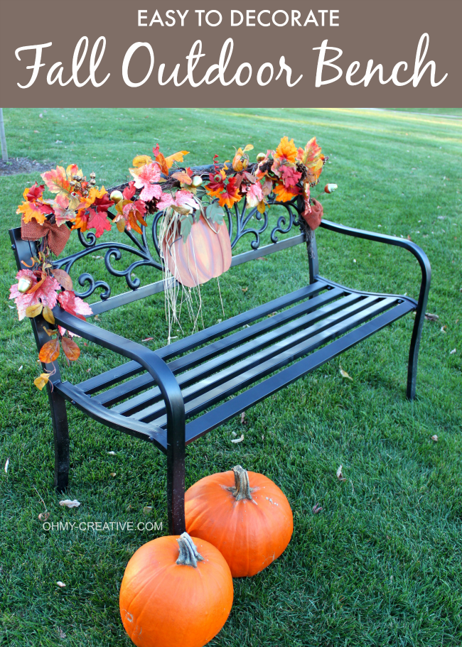 Use a pretty garland and metal pumpkin to create this easy to Decorate a Fall Outdoor Bench | OHMY-CREATIVE.COM