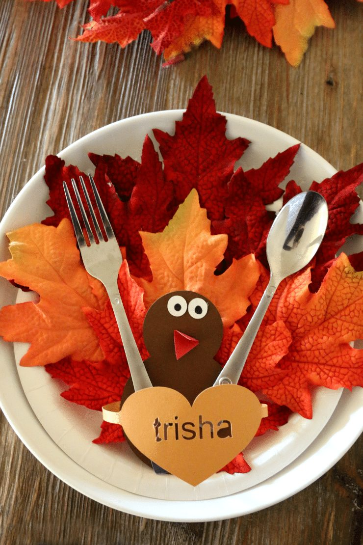 construction paper and silk leaves make this turkey craft perfect to use as place settings on the Thanksgiving table.