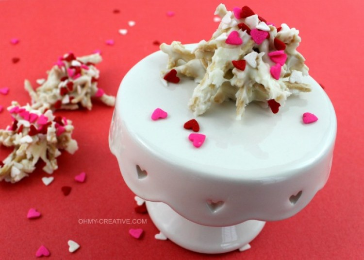 A cute Valentine's twist on a favorite cookie using sprinkles! White Chocolate Valentine Haystacks Cookies | OHMY-CREATIVE.COM
