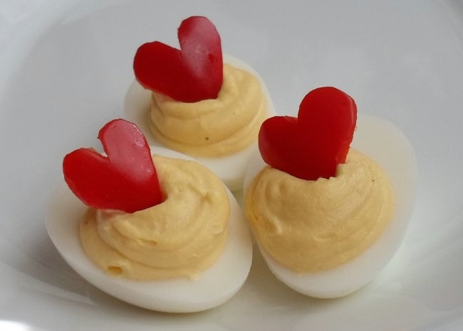 deviled eggs with red pepper hearts