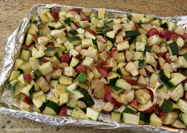 """This is one of my favorite """"go to"""" recipes. Not only is this Roasted Potatoes And Zucchini Side Dish easy to make it is also delicious and compliments any main course!   OHMY-CREATIVE.COM"""
