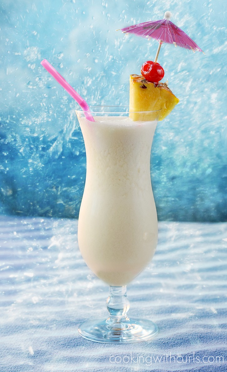A sweet tropical cocktail made with rum pineapple juice and coconut cream cookingwithcurls.com