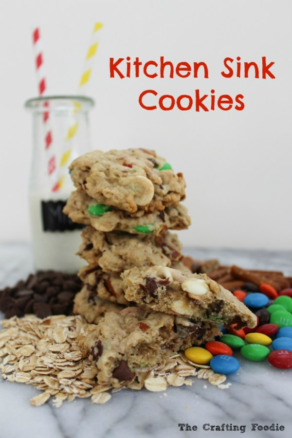 These chewy, soft Kitchen Sink Cookies are filled with chocolate chips, white chocolate, oatmeal, M&M's and one unique add-in that gives these cookies a salty, crunch. The Crafting Foodie for OHMY-CREATIVE.COM