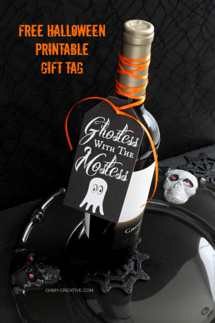 Don't go to a Halloween party empty handed!! Use this Free Halloween Printable Gift Tag to attach to a bottle or gift bag for a Halloween party hostess gift…Ghostess with the Mostess | OHMY-CREATIVE.COM