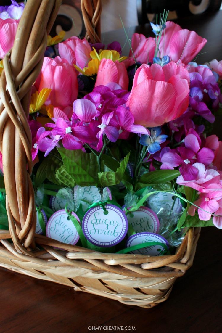 A basket of flowers and homemade sugar scrub shower favors