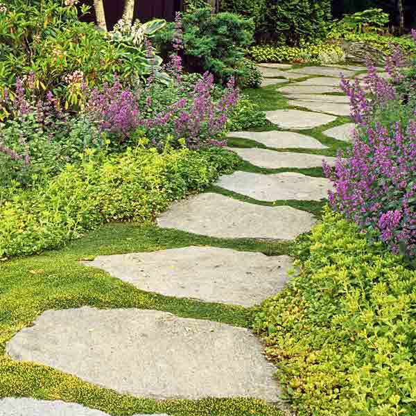 Stone Pathway - lay stones or rocks down to create a pathway in your garden, to your front door, or to and from a porch or patio | OHMY-CREATIVE.COM