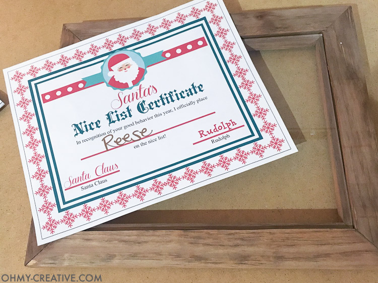 This is such a fun idea for a night before Christmas tradition! Let the kids know they made Santa's list with this easy DIY Christmas Photo Frame and a Nice List Certificate signed by Santa Claus. They will love going to bed knowing they will wake up to presents under the tree.   OHMY-CREATIVE.COM