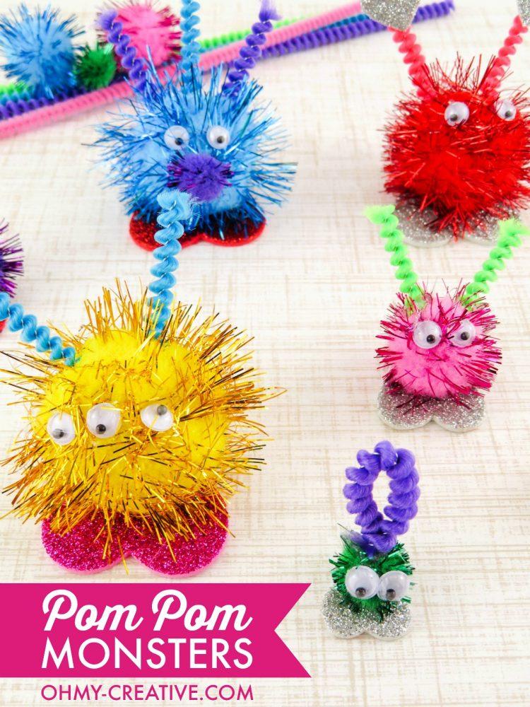 These Pom Pom Monsters are and easy kids craft!   OHMY-CREATIVE.COM   Valentine's Day Craft   Valentine Pom Pom Monsters   pom pom craft   preschool craft   kindergarten craft   pom pom animals   pom pom creatures