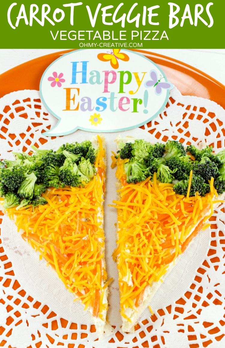 Carrot Vegetable Pizza Recipe with an Easter twist! Chopped veggies with a Crescent Roll crust make these veggie bars a fun Easter appetizer or brunch menu item.   OHMY-CREATIVE.COM   carrot   carrot appetizer   side dish recipe   crescent rolls   cheese   broccoli   Easter recipe   Easter brunch