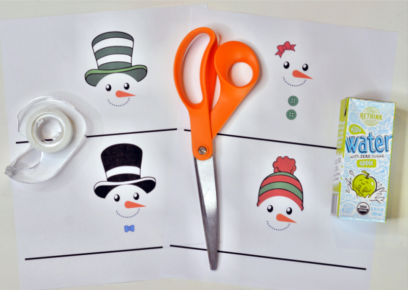 These Free Printable Snowman Juice Box Covers are a perfect accent to cover kids juice boxes for Christmas parties or any winter party festivities! OHMY-CREATIVE.COM #juiceboxcovers #printablejuiceboxcovers #snowmanprintable #christmasprintable #winterprintable