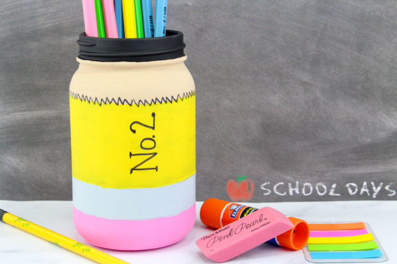 finished pencil mason jar with pencils and other school supplies