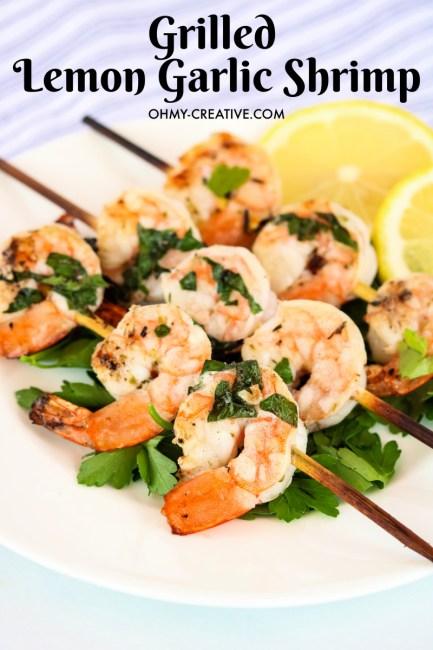 grilled lemon garlic shrimp garnished with lemon on a plate.
