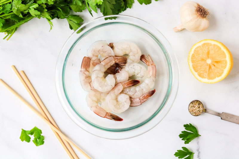 Uncooked shrimp in a bowl for grilling