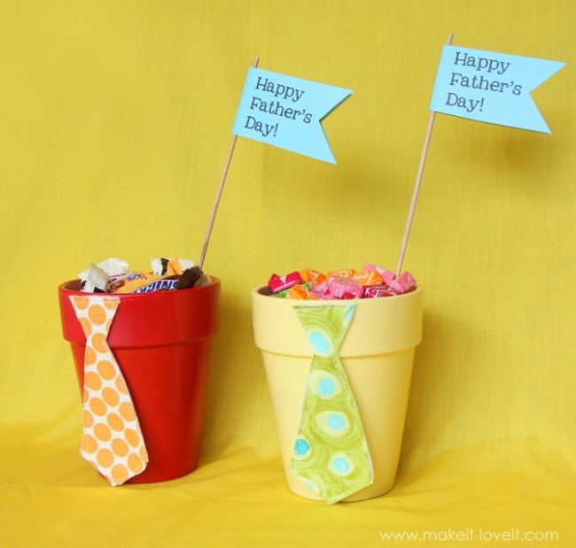 Painted flower pots filled with favorite candy and Happy Father's Day flyer