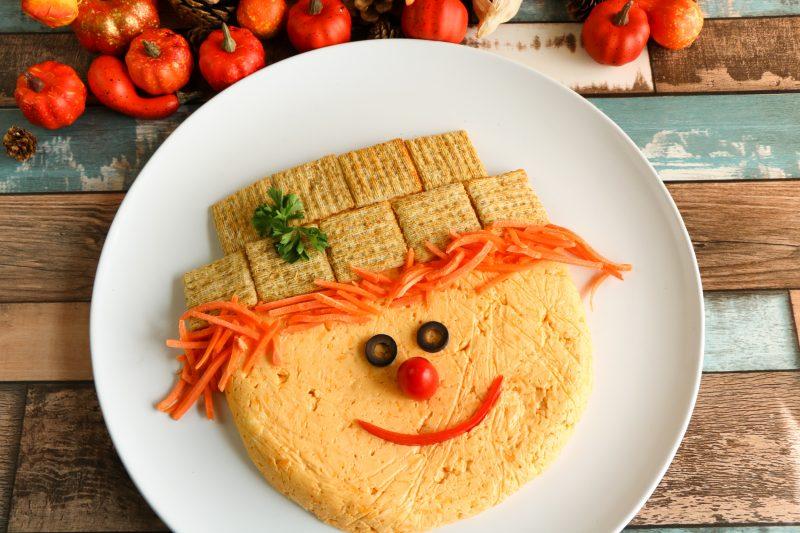 If you are looking for a really fun appetizer for Thanksgiving or another fall party, then this one is perfect! Everything on this adorable scarecrow is edible, but he's so cute you won't want to eat it!