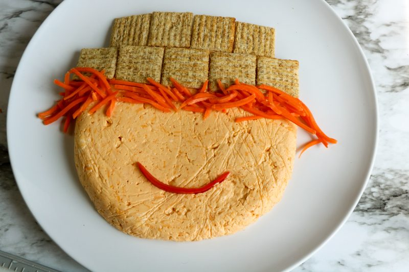 Scarecrow face is made of sliced olives for eyes, a tomato nose and a slice of red pepper for the mouth!
