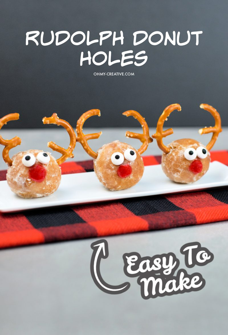 Three Rudolph Donut Holes sitting on a while dish placed on a buffalo plaid napkin.