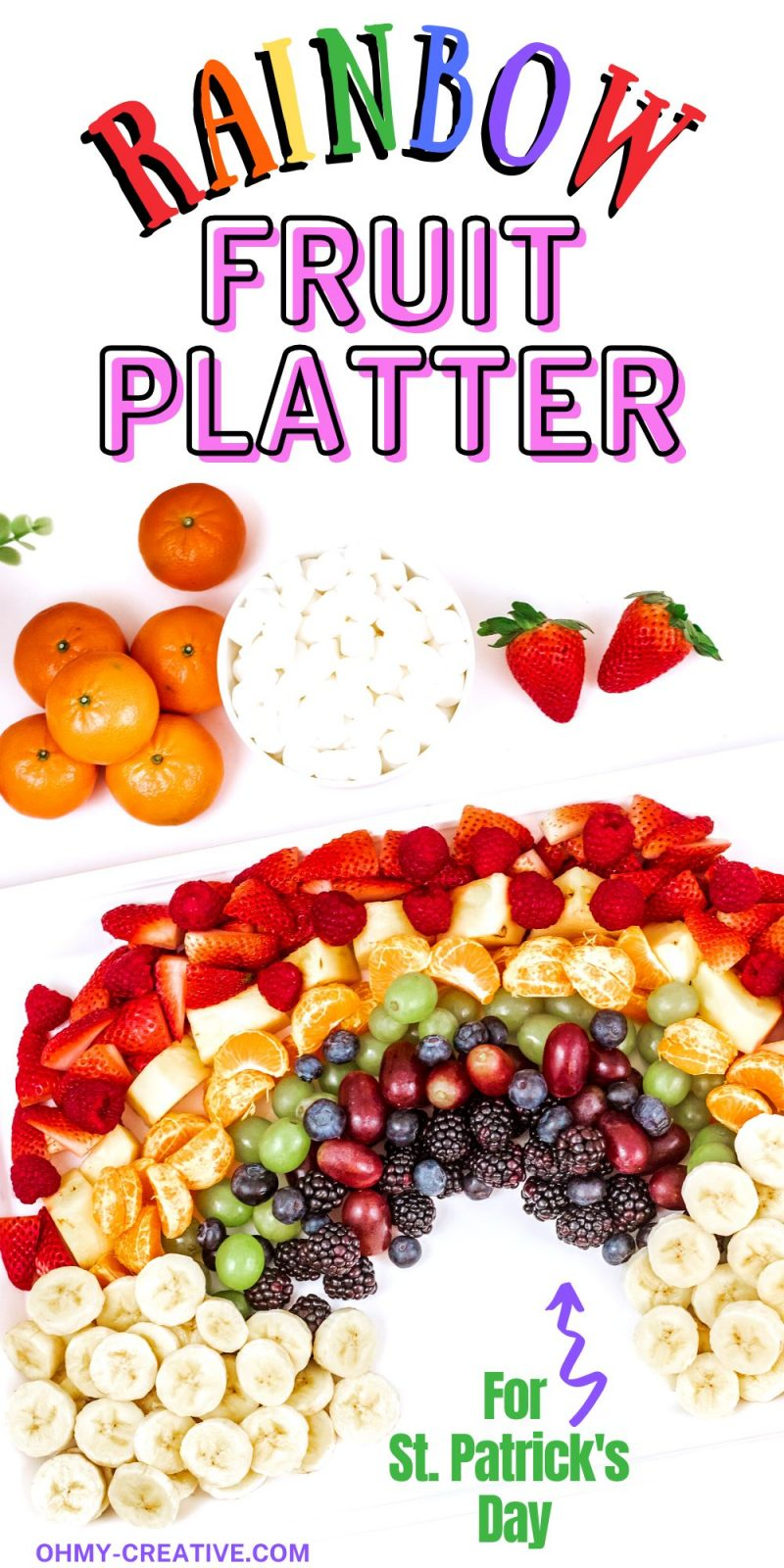 Assembled Rainbow fruit platter with bananas as the clouds. A bowl of marshmallows is also pictured as and option for clouds.