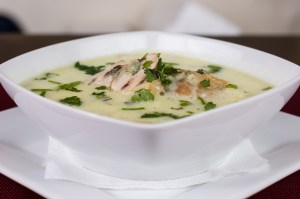 Creamed soup in a square white bowl.
