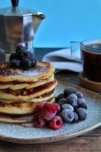 stack of pancakes with blueberries and raspberries