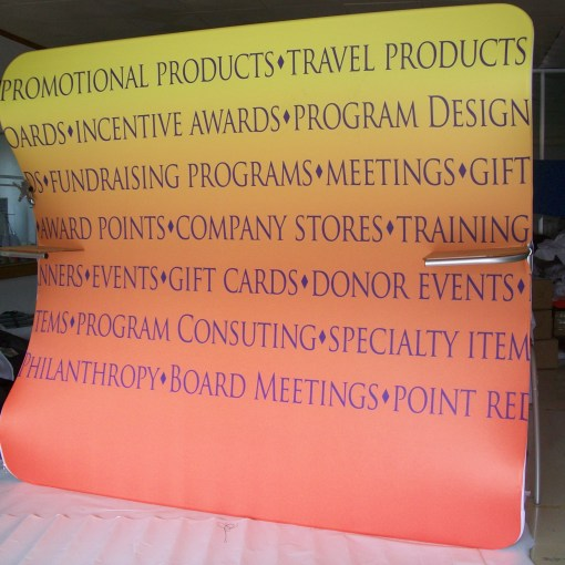 Curved-Fabric-Display-Backdrop-with-Shelves