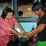 Nikka Shae rinsing after an iwi Fresh massage by Yaya - the lady with the golden touch
