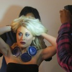 Model prepares for photo session wearing the Purple Haze necklace from the Rock Steady collection