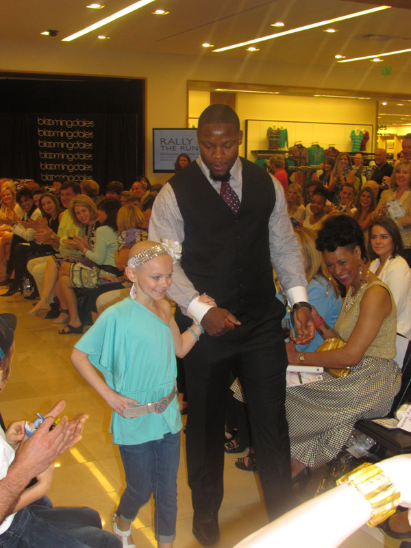 Rally Kid Tori dazzles the crowd with honorary chair and Atlanta Falcons star Curtis Lofton